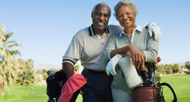 man and woman on golf course