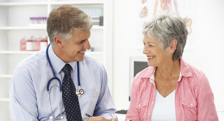 doctor talking to an older female patient