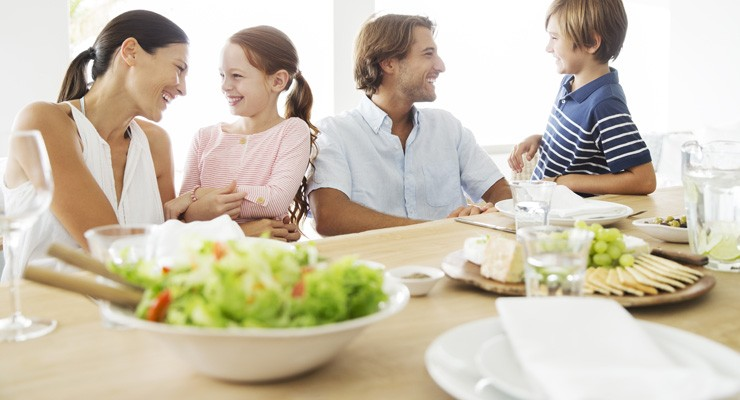 family at dinner table with healthy food