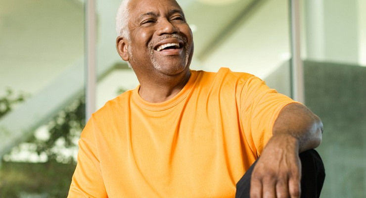older man sitting on weight bench