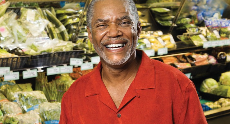 smiling man in grocery store
