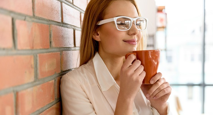 image of woman drinking from a mug