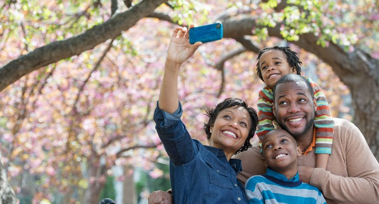 family taking a selfie in the park