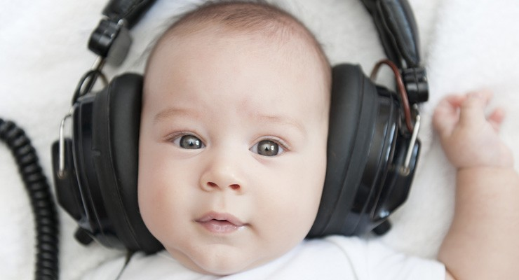 small baby with big headphones on